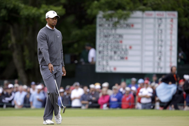 Tiger Woods waits to putt on the 14th hole during the first round of the U.S. Open golf tournament at Merion Golf Club, Friday, June 14, 2013, in Ardmore, Pa. (AP Photo/Morry Gash)