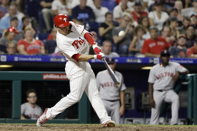 Philadelphia Phillies' Scott Kingery hits an RBI sacrifice fly off Boston Red Sox relief pitcher Joe Kelly during the sixth inning of a baseball game Wednesday, Aug. 15, 2018, in Philadelphia. Philadelphia won 7-4. (AP Photo/Matt Slocum)