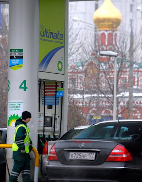 FILE - An employee of a BP gasoline station attends to a customer in Moscow, in this file photo dated Thursday, Nov. 16, 2006. On Monday Oct. 22, 2012, British oil company BP confirmed for the first time, that it is in advanced talks about selling its stake in TNK-BP to Russia's state-controlled oil company Rosneft, in a near $30 billion deal.(AP Photo/ Mikhail Metzel, File)