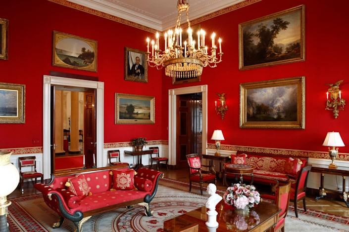 This Sept. 17, 2019, photo shows refreshed wall fabric in the Red Room of the White House in Washington.