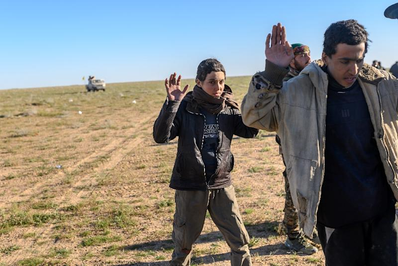 """Suspected Islamic State group fighters have been detained by the US-backed Syrian Democratic Forces as they have left the final scrap of the """"caliphate"""" (AFP Photo/Bulent KILIC)"""