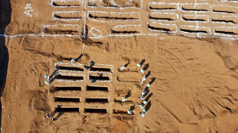 An aerial view shows Libyan experts exhuming human remains from mass graves in Tarhuna, southeast of the capital Tripoli