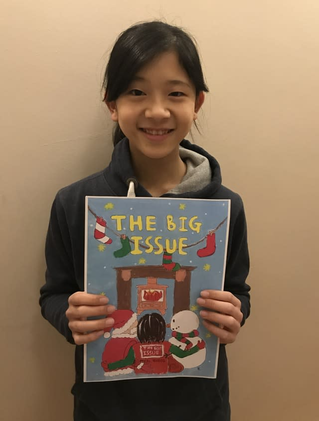 Twelve-year-old Kaoriko Tamura with her painting of a Big Issue seller next to Father Christmas and a snowman
