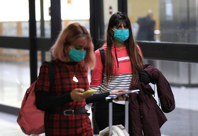 Passengers are pictured wearing masks at International Baghdad Airport on 4 March. Iraq has 32 confirmed cases. (Getty Images)
