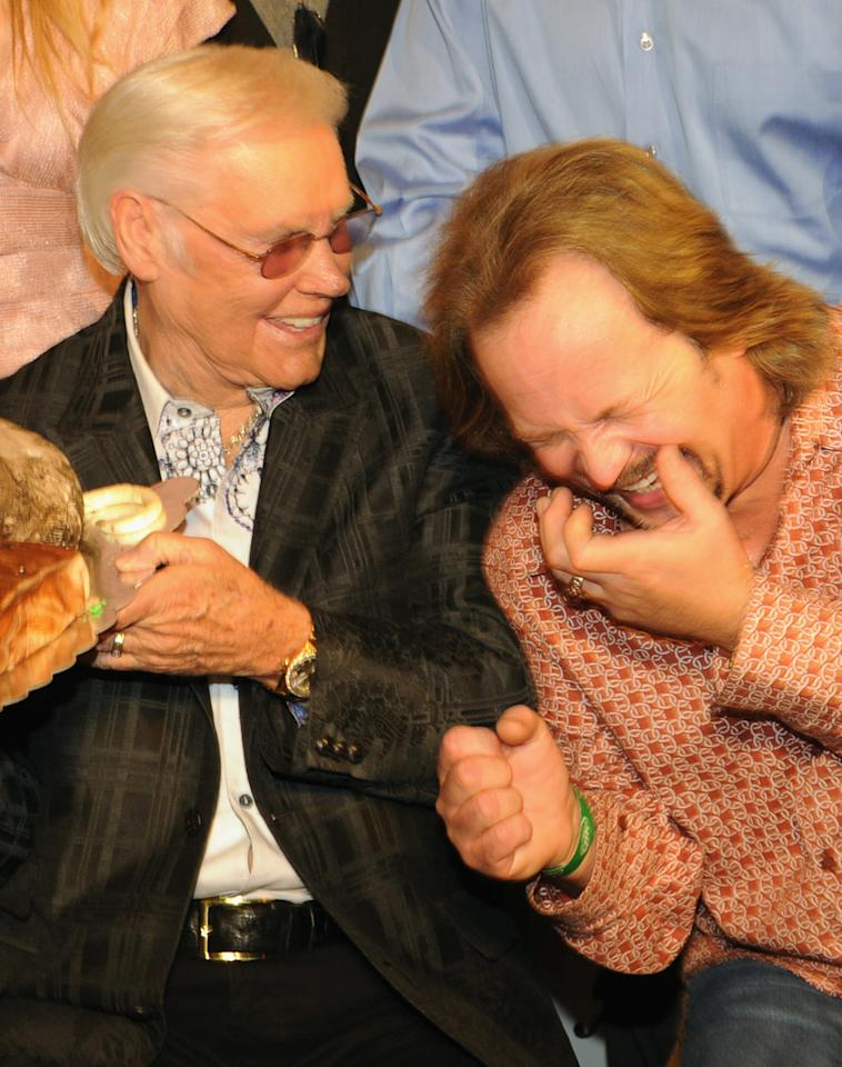 NASHVILLE, TN - SEPTEMBER 13:  Country Music Legend George Jones and Singer/Songwriter  Travis Tritt celebrate at his George Jones' 80th birthday party at Rippy's Bar & Grill on September 13, 2011 in Nashville, Tennessee.  (Photo by Rick Diamond/Getty Images)