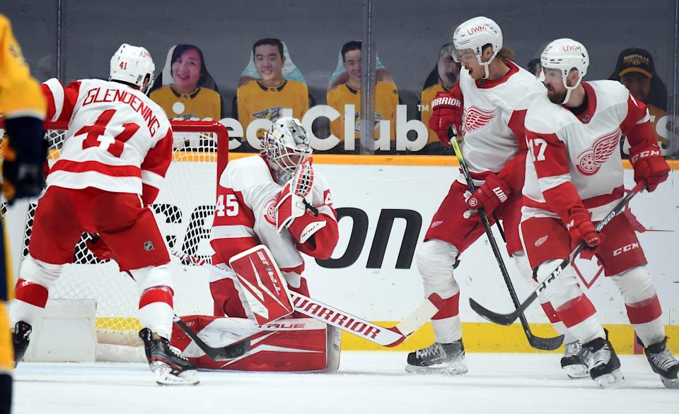 Detroit Red Wings goaltender Jonathan Bernier (45) holds onto the puck after a save against the Nashville Predators during the second period at Bridgestone Arena in Nashville, Tenn., on Feb. 13, 2021.