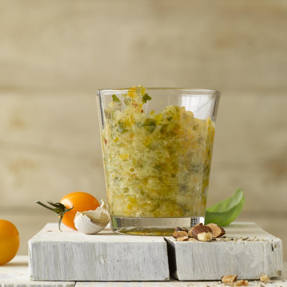 <p>In a twist on classic pesto, this healthy recipe uses less oil than a traditional basil pesto, includes tomatoes and subs almonds for pine nuts. Try it tossed with whole-wheat pasta or slathered over grilled chicken or fish.</p>