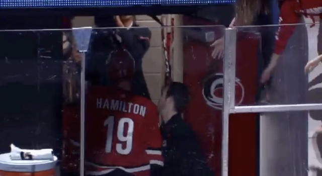 Carolina's Dougie Hamilton gives Patrick Budds a tap where the sun don't shine following the Hurricanes' 4-3 overtime win against the Tampa Bay Lightning on Sunday night. (Twitter//@HeresYourReplay)