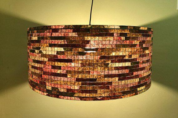 """Nicknamed as """"art with coffee filters"""", the artisan behind <span>Lampada</span> sells completely unique and eco-friendly lamp shades that are made from recycled coffee filters and dyed with water-based paint."""