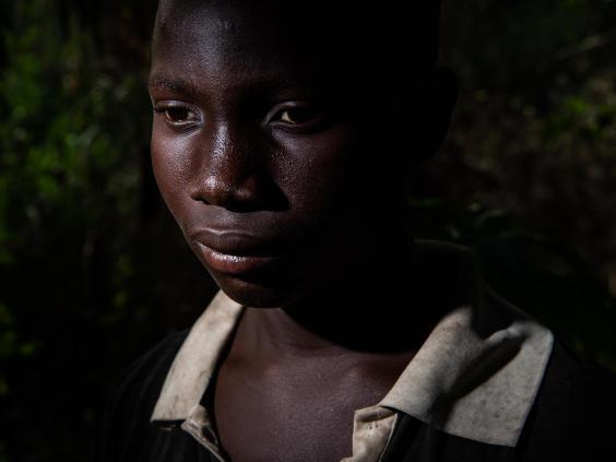Abou Ouedrago, 15, from Burkina Faso, sleeps in a hut out in the woods, spends his days doing hard manual labour, doesn't attend school or see his family
