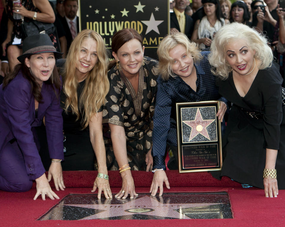 FILE - The female band The Go-Go's, from left, Kathy Valentine, Charlotte Caffey, Belinda Carlisle, Gina Schock and Jane Wiedlin pose at their star on the Hollywood Walk of Fame in Los Angeles on Aug. 11, 2011. The band made this year's list of honorees to the Rock and Roll Hall of Fame. The ceremony, to be held at the Rocket Mortgage Fieldhouse in Cleveland, will be simulcast on SiriusXM and air later on HBO. (AP Photo/Damian Dovarganes, File)