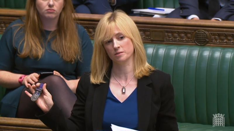 Labour MP for Canterbury, Rosie Duffield, holds up a medal from one of her constituents in the House of Commons in London.