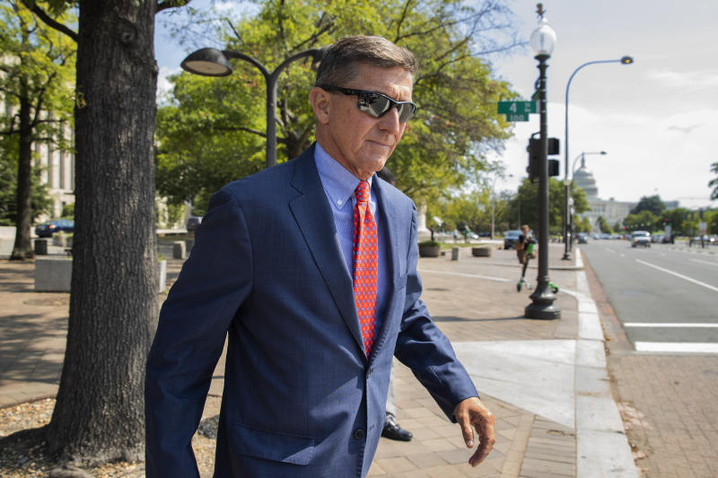 FILE - In this Sept. 10, 2019 file photo, Michael Flynn, President Donald Trump's former national security adviser, leaves the federal court following a status conference in Washington. FBI Director Christopher Wray has ordered an internal review into possible misconduct in the investigation of former Trump administration national security adviser Michael Flynn. That's according to an FBI statement issued Friday. (AP Photo/Manuel Balce Ceneta)