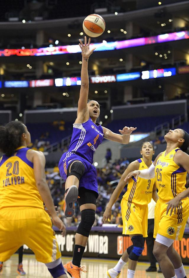 Phoenix Mercury forward Candice Dupree, second from left, puts up a shot as Los Angeles Sparks guard Kristi Toliver, left, center Candace Parker, second from right, and forward Marissa Coleman defend during the first half of Game 3 of a WNBA basketball Western Conference semifinal series, Monday, Sept. 23, 2013, in Los Angeles. (AP Photo/Mark J. Terrill)