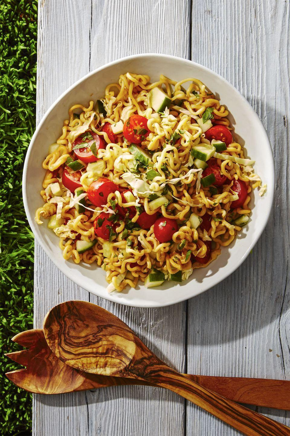 """<p>Your fave dorm dinner becomes a sweet and sour side with some help from sliced veggies and a tahini soy dressing.</p><p><em><a href=""""https://www.goodhousekeeping.com/food-recipes/a39330/honey-lime-ramen-salad-recipe/"""" rel=""""nofollow noopener"""" target=""""_blank"""" data-ylk=""""slk:Get the recipe for Honey-Lime Ramen Salad »"""" class=""""link rapid-noclick-resp"""">Get the recipe for Honey-Lime Ramen Salad »</a></em></p>"""