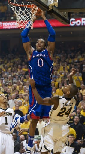 Kansas' Thomas Robinson, center, shoots over Missouri's Kim English, right, as teammate Phil Pressey, left, looks on during the first half of an NCAA college basketball game on Saturday, Feb. 4, 2012, in Columbia, Mo. (AP Photo/L.G. Patterson)