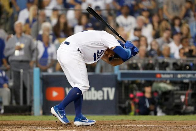 Austin Barnes of the Los Angeles Dodgers reacts after striking out in the sixth (AFP Photo/Sean M. Haffey)