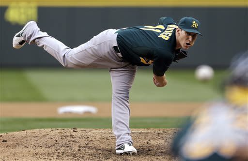 Oakland Athletics starting pitcher Jarrod Parker throws against the Seattle Mariners in the fourth inning of a baseball game on Saturday, May 11, 2013, in Seattle. (AP Photo/Elaine Thompson)