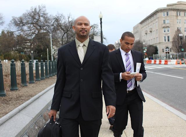 Former Northwestern University football quarterback Cain Colter, right, and Ramogi Huma, founder and president of the National College Players Association arrive on Capitol Hill in Washington Wednesday, April, 2, 2014. Members of a group seeking to unionize college athletes are looking for allies on Capitol Hill as they brace for an appeal of a ruling that said full scholarship athletes at Northwestern University are employees who have the right to form a union. Former Northwestern quarterback Kain Colter _ the face of a movement to give college athletes the right to unionize _ and Ramogi Huma, the founder and president of the National College Players Association, scheduled meetings Wednesday with lawmakers. (AP Photo/Lauren Victoria Burke)