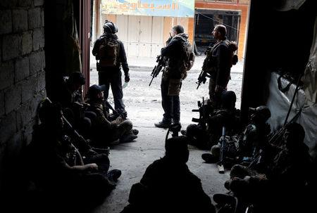 Iraqi special forces soldiers rest inside a house during a battle with Islamic State militants in Mosul, Iraq March 2, 2017. REUTERS/Goran Tomasevic