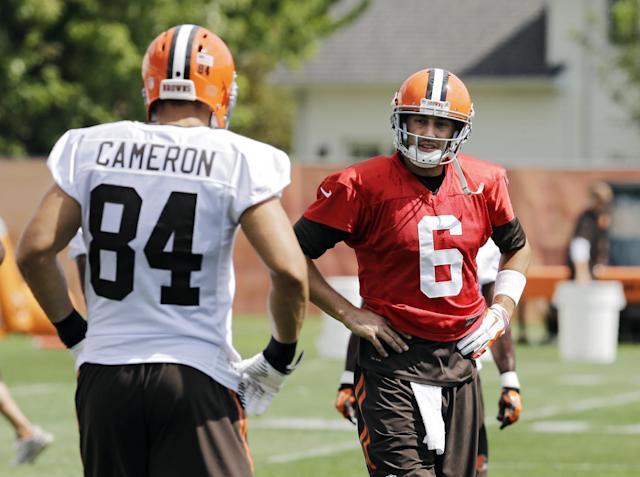 Cleveland Browns quarterback Brian Hoyer (6) talks to tight end Jordan Cameron (84) during practice at the NFL football team's facility in Berea, Ohio Wednesday, Sept. 3, 2014. (AP Photo/Mark Duncan)