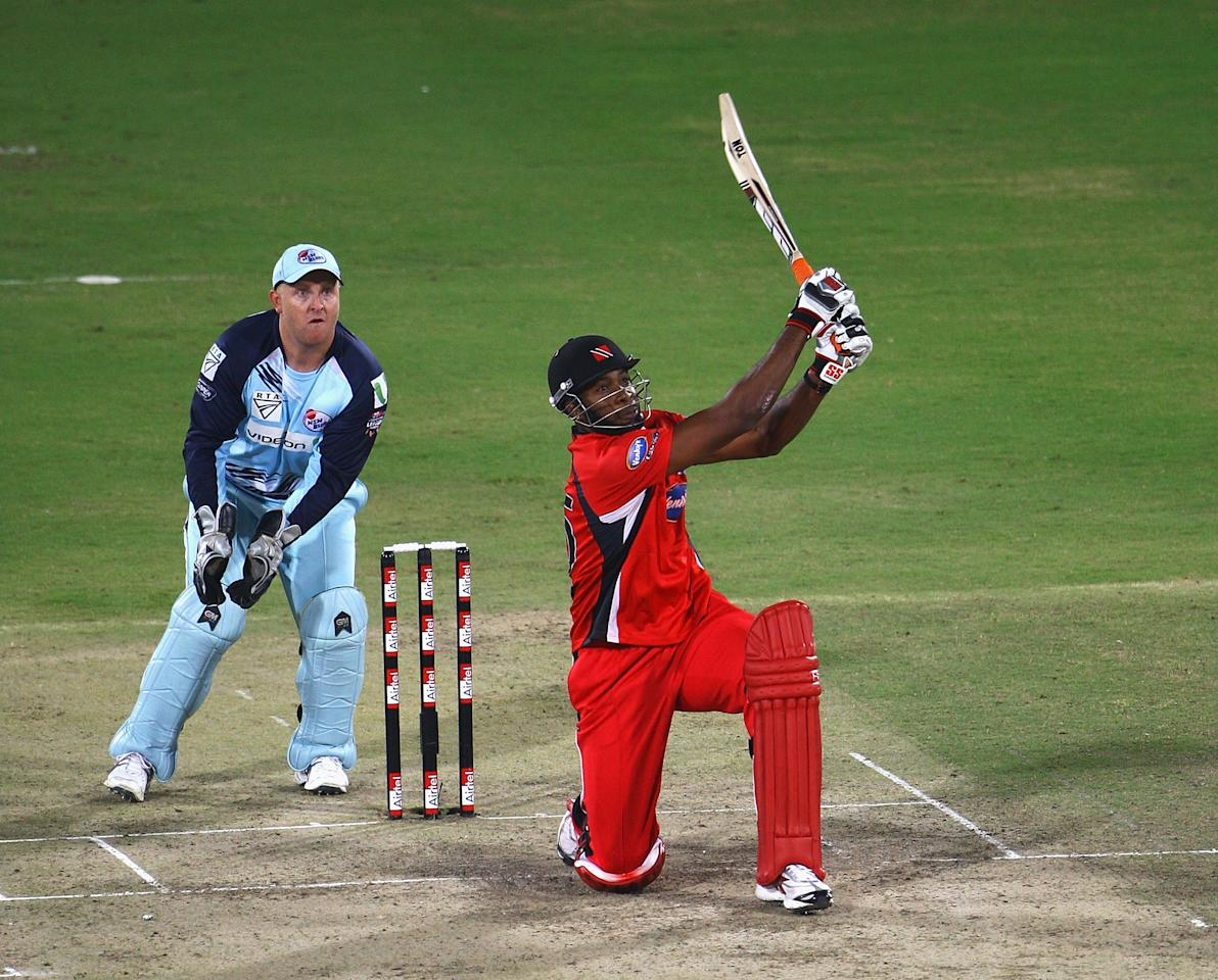 HYDERABAD, INDIA - OCTOBER 23:  Kieron Pollard of Trinidad & Tobago hits a six, as Daniel Smith of NSW looks on during the Airtel Champions League Twenty20 Final between NSW and Trinidad & Tobago at the Rajiv Gandhi International Stadium  on October 23, 2009 in Hyderabad, India.  (Photo by Matt Lewis - GCV/GCV via Getty Images)