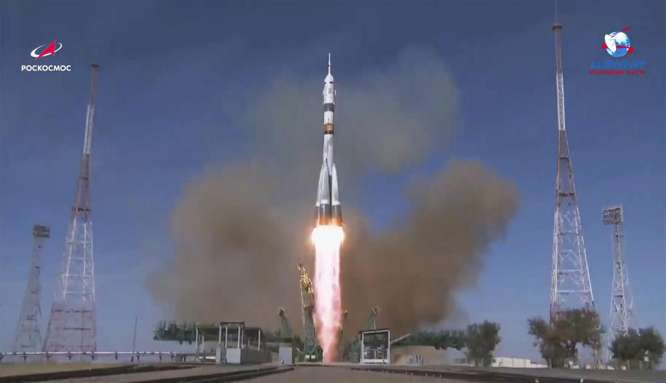 In this image made from video footage released by Roscosmos Space Agency, the Soyuz-2.1a rocket booster with Soyuz MS-17 space ship carrying a new crew to the International Space Station (ISS), blasts off at the Russian leased Baikonur cosmodrome, Kazakhstan, Wednesday, Oct. 14, 2020. A trio of space travelers has launched successfully to the International Spce Station, for the first time using a fast-track maneuver to reach the orbiting outpost in just three hours. NASA's Kate Rubins and Sergey Ryzhikov and Sergey Kud-Sverchkov of the Russian space agency Roscosmos lifted off as scheduled at 10:45 a.m. (1:45 a.m. EDT, 5:45 a.m. GMT) Wednesday from the Russia-leased Baikonur space launch facility in Kazakhstan for a six-month stint on the station. (Roscosmos Space Agency via AP)