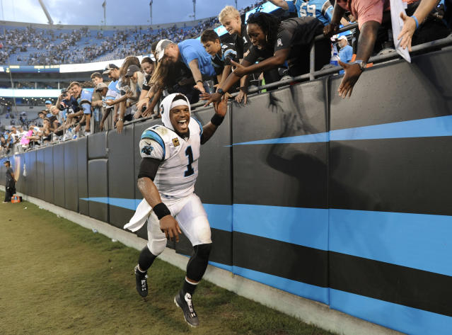 Carolina Panthers' Cam Newton (1) celebrates with fans after an NFL football game against the Dallas Cowboys in Charlotte, N.C., Sunday, Sept. 9, 2018. (AP Photo/Mike McCarn)