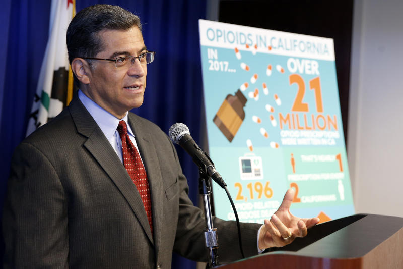 FILE - In this Monday, June 3, 2019 file photo, California Attorney General Xavier Becerra discusses the lawsuit his office has filed to Purdue Pharma for its painkiller Oxycontin, during a news conference in Sacramento, Calif. The suit, filed against Purdue and its former president, Dr. Richard Sackler, alleges it falsely promoted the drug as not addictive even as it emerged as among of the most widely abused in the United States. (AP Photo/Rich Pedroncelli)