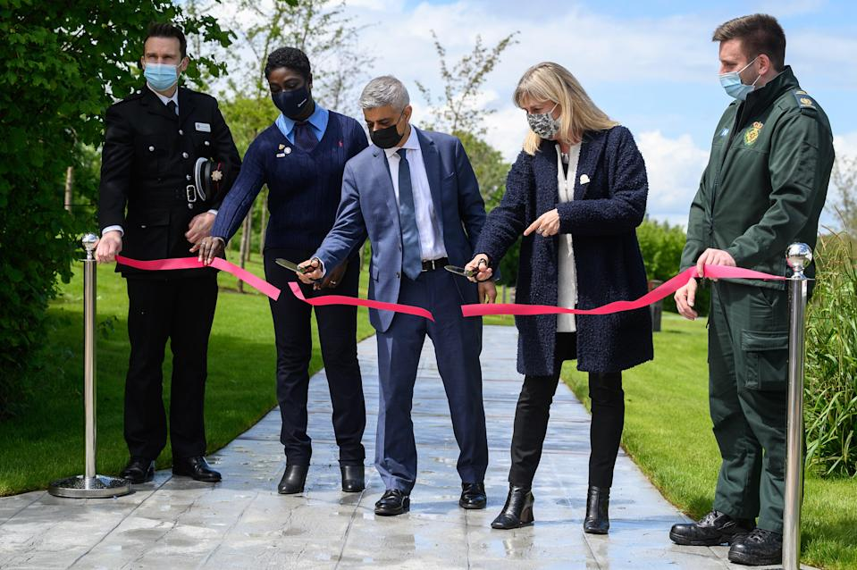 <p>Sadiq Khan is joined by key workers as he opens the London covid memorial garden</p> (Getty)