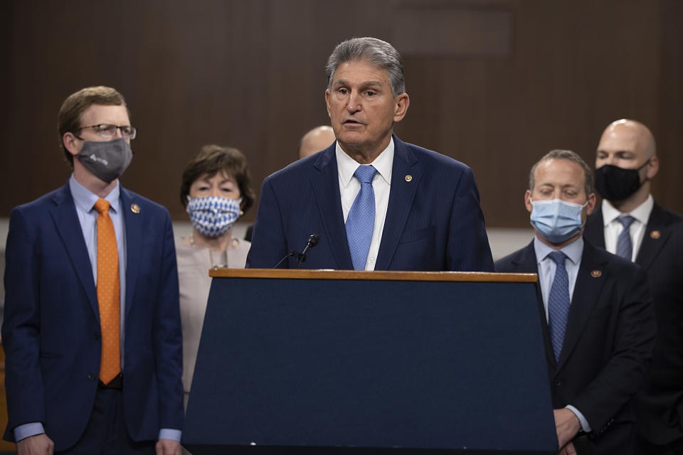 WASHINGTON, DC - DECEMBER 01: Sen. Joe Manchin (D-WV) speaks alongside a bipartisan group of Democrat and Republican members of Congress as they announce a proposal for a Covid-19 relief bill on Capitol Hill on December 01, 2020 in Washington, DC. The roughly $908 billion proposal includes $288 billion in small business aid such as Paycheck Protection Program loans, $160 billion in state and local government relief and $180 billion to fund a $300 per week supplemental unemployment benefit through March, according to a draft framework. (Photo by Tasos Katopodis/Getty Images)