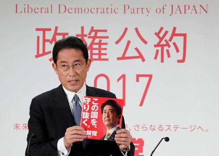 FILE PHOTO : Japan's ruling Liberal Democratic Party (LDP) policy chief Fumio Kishida unveils the party's election campaign platform during a news conference at the LDP's headquarters in Tokyo, Japan October 2, 2017.  REUTERS/Kim Kyung-Hoon/File Photo