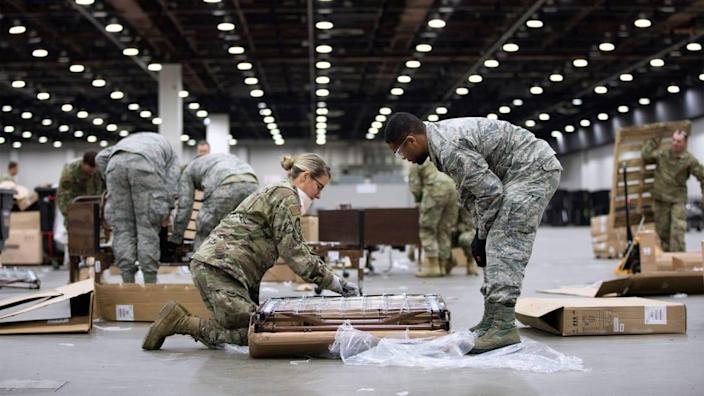 """<div class=""""inline-image__title""""> HEALTH-CORONAVIRUS/USA </div> <div class=""""inline-image__caption""""> <p>""""Members of the Michigan National Guard set up hospital beds as the Detroit TCF convention center is converted into a field hospital amid an outbreak of coronavirus disease (COVID-19) in Detroit, Michigan.""""</p> </div> <div class=""""inline-image__credit""""> Emily Elconin/Reuters </div>"""