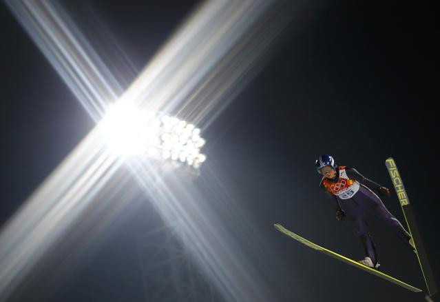 Vogt soars through the air during her trial jump in the women's ski jumping individual normal hill event at the Sochi 2014 Winter Olympic Games