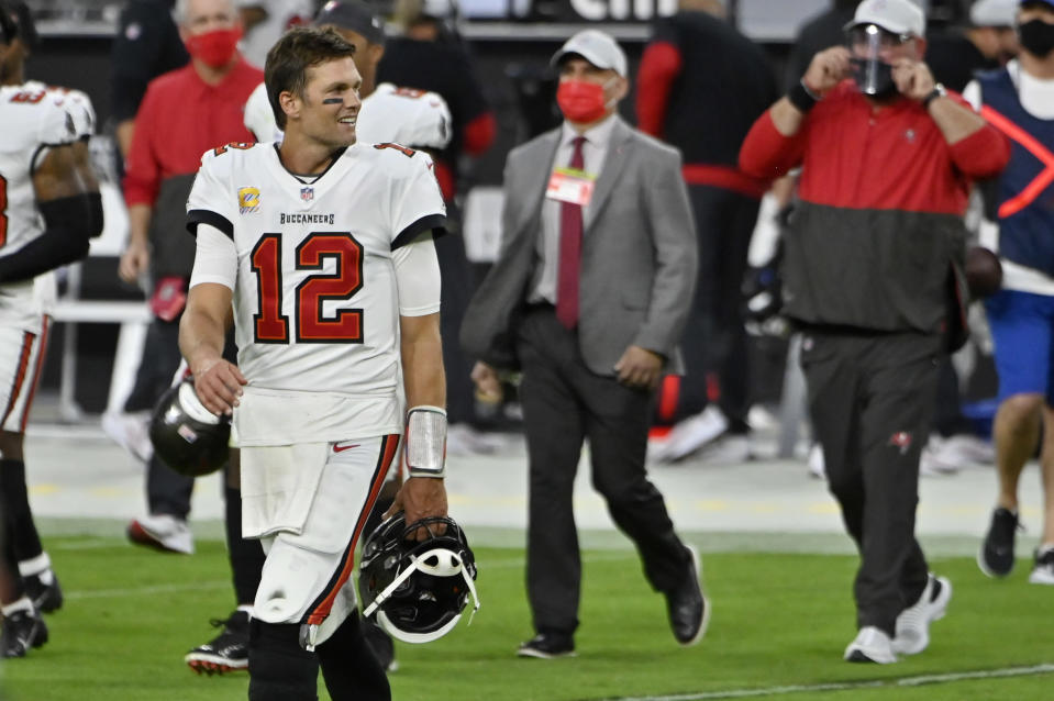 Tampa Bay Buccaneers quarterback Tom Brady (12) walks onto the field after defeating the Las Vegas Raiders in an NFL football game, Sunday, Oct. 25, 2020, in Las Vegas. (AP Photo/David Becker)