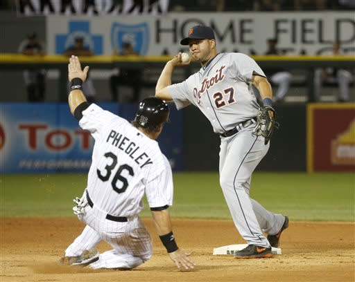 Detroit Tigers shortstop Jhonny Peralta (27) turns the double play forcing Chicago White Sox's Josh Phegley at second and getting Alexei Ramirez at first during the sixth inning of a baseball game Monday, July 22, 2013, in Chicago. (AP Photo/Charles Rex Arbogast)