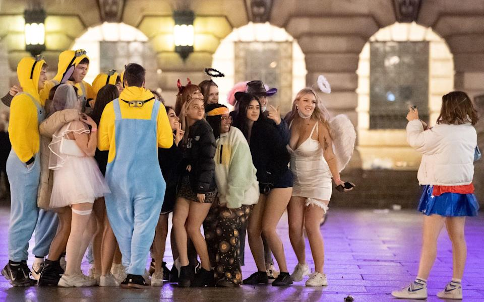 Revellers in Nottingham get in a final night of partying before entering Tier 3 -  Joe Giddens/PA