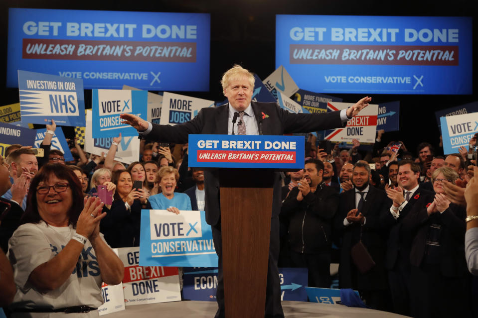 FILE - In this Wednesday, Nov. 6, 2019 file photo, Britain's Prime Minister Boris Johnson speaks during an election campaign event for his ruling Conservative Party at the NEC, (National Exhibition Centre) in Birmingham, England. Britain and the European Union have struck a provisional free-trade agreement that should avert New Year's chaos for cross-border commerce and bring a measure of certainty to businesses after years of Brexit turmoil. The breakthrough on Thursday, Dec. 24, 2020 came after months of tense and often testy negotiations that whittled differences down to three key issues: fair-competition rules, mechanisms for resolving future disputes and fishing rights. (AP Photo/Frank Augstein, File)