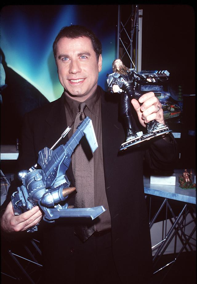 """2/14/00 New York, NY. John Travolta visits the Trendmasters Showroom to promote the launch of the high-flying toy line for his latest movie project, """"Battlefield Earth,"""" in which he plays the evil Terl, leader of the Psychlos. Photo by Robin Platzer/Twin Images/Online USA, Inc."""
