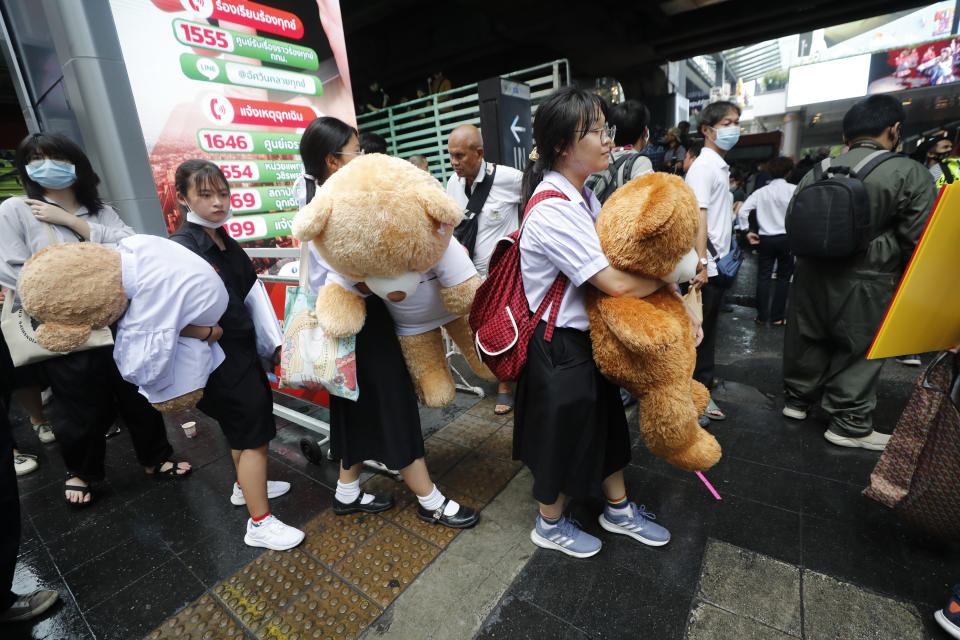 "Secondary school students hold giant teddy bears as they attend a student rally in Bangkok, Saturday, Nov. 21, 2020. Organized by a group that mockingly calls themselves ""Bad Students,"" the rally calls for educational reforms and also supports the broader pro-democracy movement's demands for constitutional change. (AP Photo/Sakchai Lalit)"