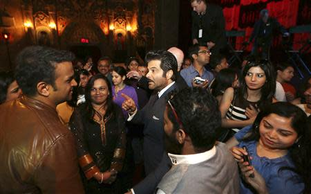Bollywood actor Anil Kapoor (C) speaks with participants of a workshop ahead of the 15th International Indian Film Academy Awards in Tampa, Florida April 24, 2014. REUTERS/Mohammed Jaffer-SnapsIndia