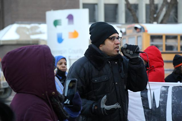 """Brock Satter leads the crowd in a chant in the shadow of the Hennepin County Medical Center at the """"Take a Knee"""" rally by Black Lives Matter and other groups in Minneapolis, Minnesota, U.S., February 4, 2018, near the stadium where the Super Bowl is played. REUTERS/Matt Blewett NO RESALES. NO ARCHIVE."""