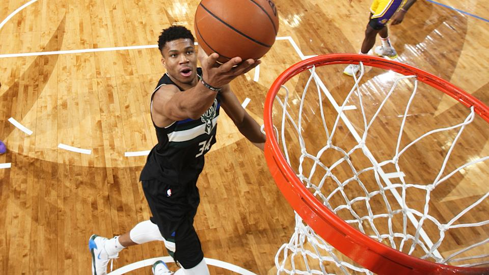 Giannis Antetokounmpo, pictured attempting a lay-up, helped Milwaukee to a win over the LA Lakers.