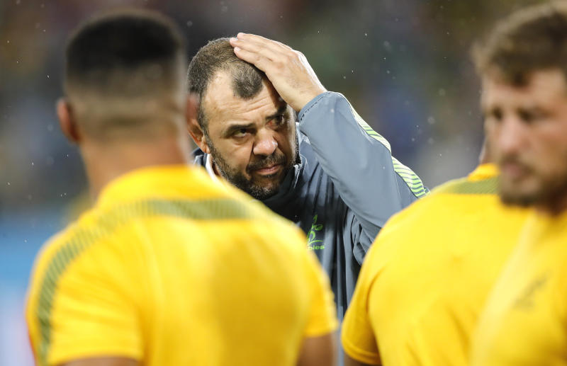Australia coach Michael Cheika watches as his players warm up ahead of the Rugby World Cup Pool D game at Shizuoka Stadium Ecopa between Australia and Georgia in Shizuoka, Japan, Friday, Oct.11, 2019. (AP Photo/Christophe Ena)