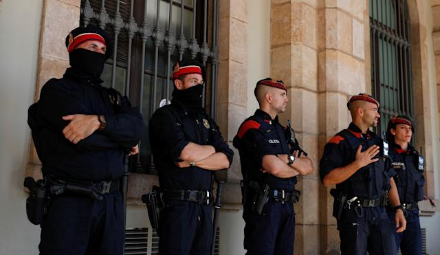 Mossos d'Esquadra, Catalan regional police officers, stand guard outside the Catalonian regional parliament in Barcelona, Spain, October 10, 2017.
