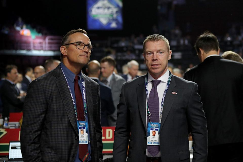 Steve Yzerman and Kris Draper of the Detroit Red Wings attend the NHL draft at Rogers Arena on June 22, 2019 in Vancouver.