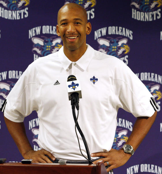 FILE - In this Dec. 17, 2011, file photo, New Orleans Hornets head coach Monty Williams talks to reporters during an NBA basketball news conference in New Orleans. The Hornets won the lottery for the league's No. 1 draft pick, Wednesday, May 30, 2012, in New York. (AP Photo/Jonathan Bachman, File)