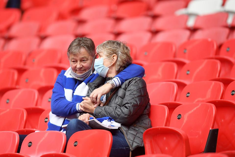 <p>Two fans share a moment ahead of the match</p> (The FA via Getty Images)