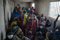 Siny Gueye, center left, is joined by other women fish processors to sing a blessing and thankful song at Bargny beach, some 35 kilometers (22 miles) east of Dakar, Senegal, Thursday April 1, 2021. (AP Photo/Leo Correa)