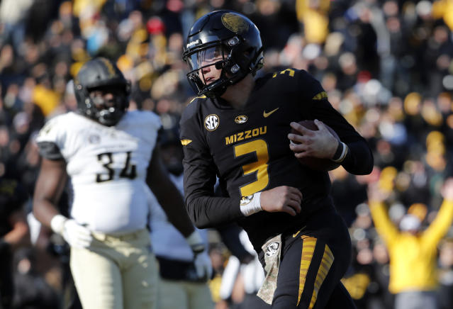 FILE - In this Nov. 10, 2018, file photo, Missouri quarterback Drew Lock scores on a 3-yard touchdown run during an NCAA college football game against Vanderbilt in Columbia, Mo. Tennessee has an opportunity Saturday to show how far it has come in the last year. The Volunteers can become bowl eligible by beating Missouri in their home finale. (AP Photo/Jeff Roberson, File)